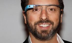 Google co-founder Sergey Brin with his creepy toy